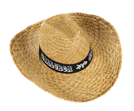 Straw hat that says Mallorca on white background photo