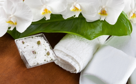 Spa accessories with orchid flowers on wooden table photo