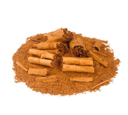 cinnamomum: Sticks and ground ceylon cinnamon on white table