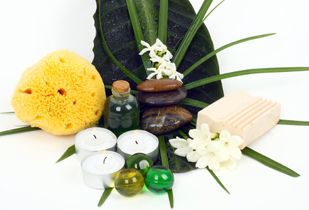 Accessories for spa with flowers of jasmine on white background photo