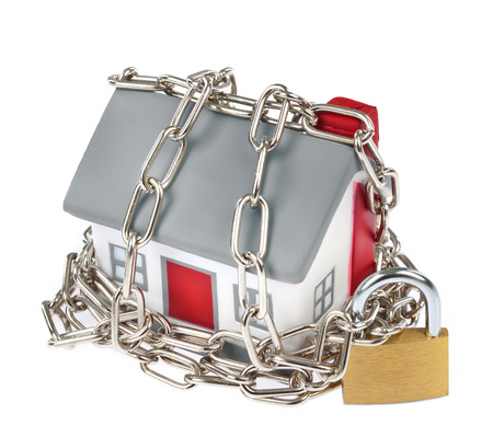 House model plastic with chain and padlock for security concept Stock fotó