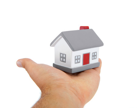 House model toy plastic in hand on white background Stock Photo