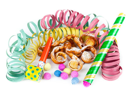 crostoli: Typical Italian dessert for carnival, chiacchiere fries with toys and confetti. Stock Photo