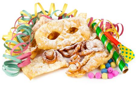 viareggio: Typical Italian dessert for carnival, chiacchiere fries with toys and confetti. Stock Photo