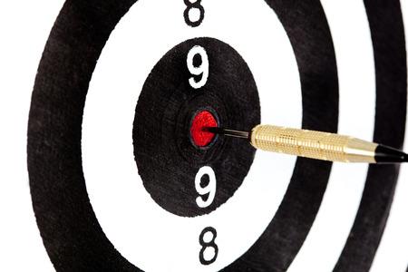 Bulls eye target with dart on white background photo