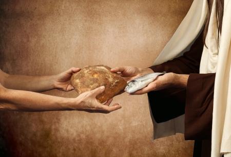 christian fish: Jes�s da pan y los peces en el fondo de color beige