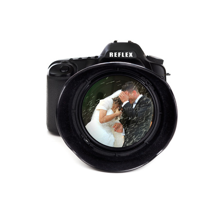 man made object: Digital photo camera on white background with groom and bride   Stock Photo