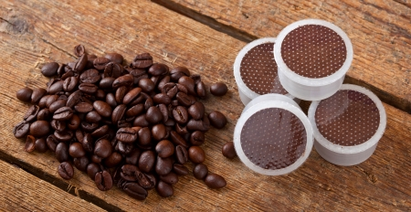 Coffee beans with pods on wooden table. Stock Photo - 24963998