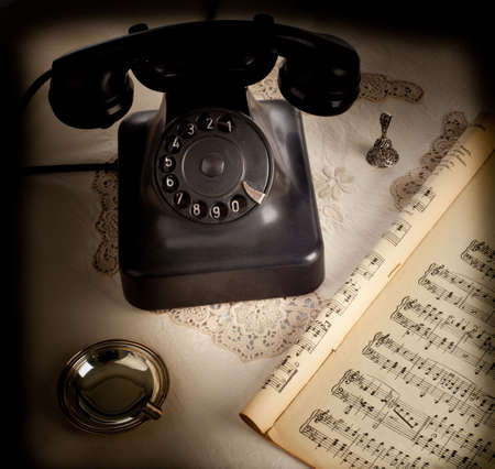 Old retro bakelite telephone on white background photo