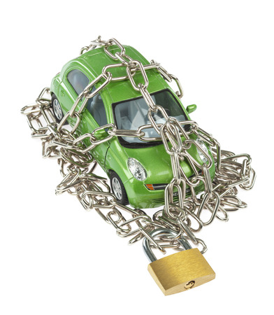 Vehicle security with padlock and chain on white background photo