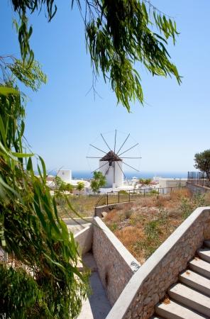 fira: Santorini windmill against a blue sky