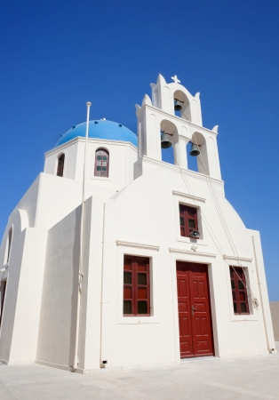 Church with blue cupola, Oia Town, Santorin, Greek Islands, Greece  photo