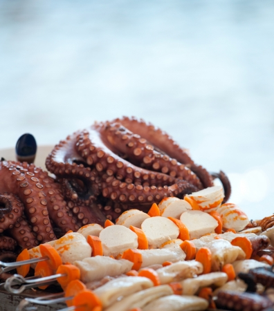 Octopus and sea fish on beach in greece photo