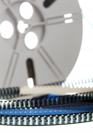 out of production: Vintage Super 8 film reel isolated on white