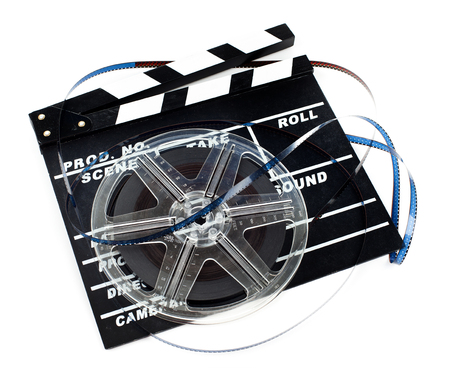 Vintage Super 8 film reel with ciak isolated on white