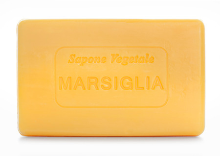 Bar of natural soap of marsiglia isolated on white photo