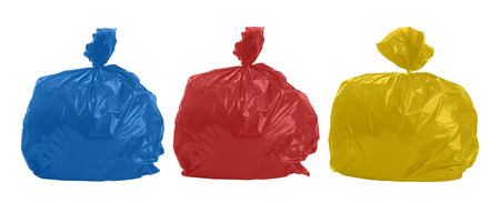 Three colored rubbish bags on white background photo