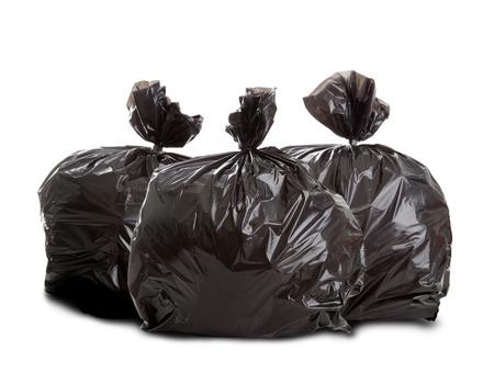Drie zwarte vuilniszakken op een witte achtergrond Stockfoto