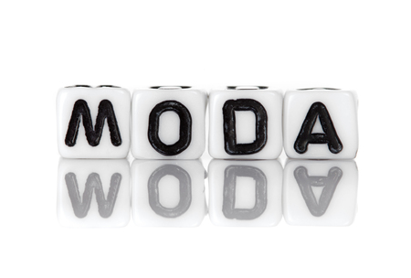 Dices with letters forming word: moda. photo