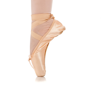 Closeup view of ballerinas feet on pointes