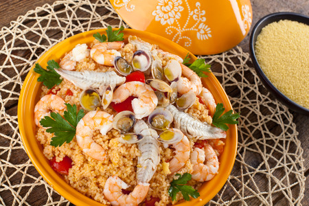 Traditional ethnic food  fish tajine with cous cous Archivio Fotografico