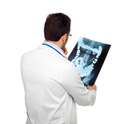 Doctor consulting a bowel radiography isolated on white Stock Photo - 25688643