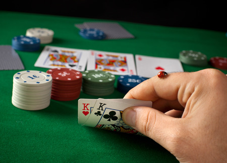 Ladybug on hand during a poker game. photo