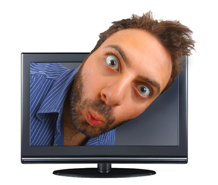 Young boy with a surprised expression in the tv. photo