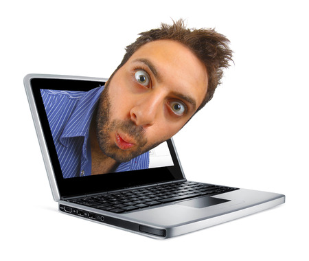 Young boy with a surprised expression in the laptop.
