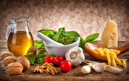 Italian pesto ingredients on wooden table photo