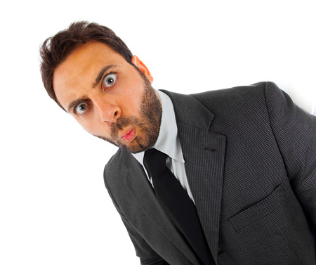 Young businessman with surprise expression on white