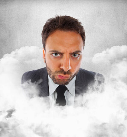 indecision: Young businessman in the clouds with expression of indecision. Stock Photo