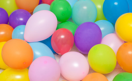 Balloons of many colours in a large pile, photo