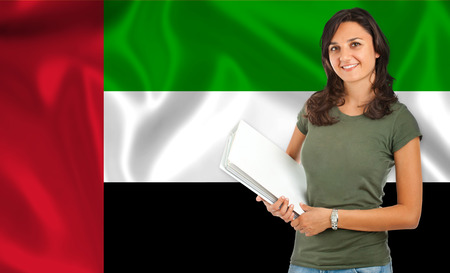 arab flags: Young female student smiling over Arab flag