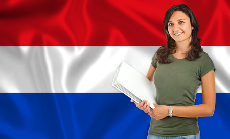 dutch girl: Young female student smiling over Dutch flag Stock Photo