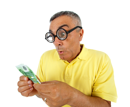 communicative: Surprised man with money and WOW expression on white backgound. Stock Photo