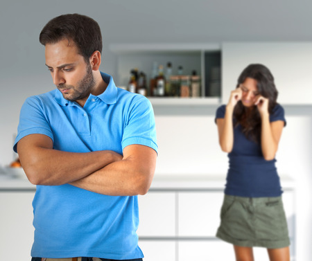 battered woman: Couple in quarrel for problems related to alcohol. Stock Photo