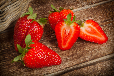 Beautiful big strawberries on wooden table photo