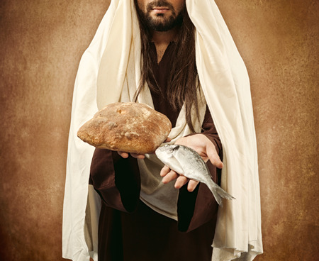 multiplication: Jesus gives bread and fish on beige background
