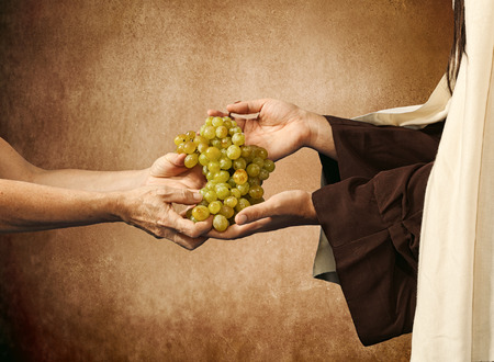 last supper: Jesus gives grapes to a beggar on beige background