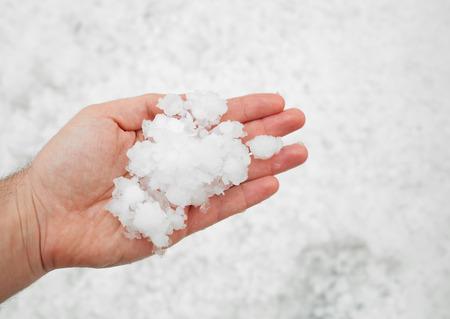 crestfallen: Small grains of hail in the hand  Stock Photo