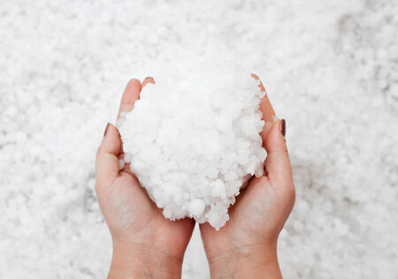crestfallen: Small grains of hail in the hands  Stock Photo