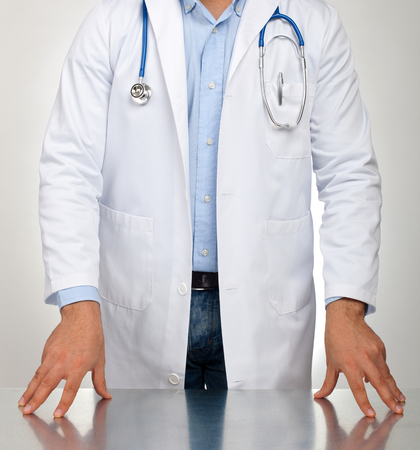 urologist: Doctor with hands resting on the table for examination. Stock Photo
