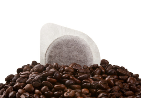 Coffee pods and beans isolated on white background.