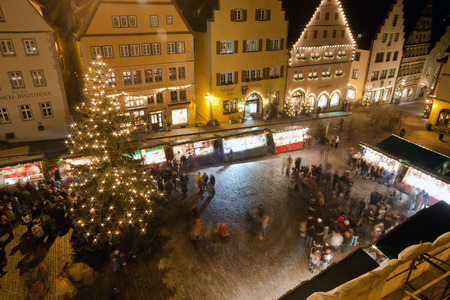 der: Christmas Market square by night in Rothenburg ob der Tauber, Germany Editorial
