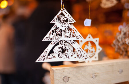 Wooden Decoration for sale in Christmas market, Munich. photo