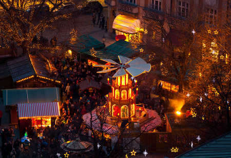 christkindlmarkt: Typical wooden christmas carousel, Munich, Bavaria, Germany.