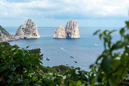 Faraglioni, famous giant rocks, Capri island in Italy photo