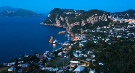 Capri island by night, Campania, Italy  Capri is an island in the Tyrrhenian Sea near Naples  photo
