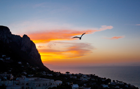 Sunset on Capri Island with typical village  photo